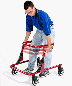 A man, using the knobs on the side of the device, adjusts the height of the red Pacer gait training frame up and down