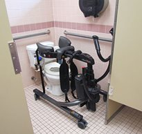 The Rifton TRAM positioned over a toilet is a sit to stand transfer device that is helping patients with cerebral palsy.