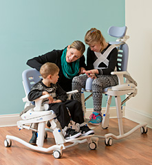 The Rifton HTS adapts to a childs size with adjustable features as shown with children that are several years apart in age.