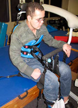 A TBI patient being transferred using the SoloLift and TRAM devices.