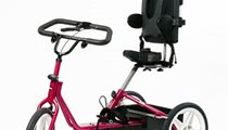 glamour shot of a pink adaptive tricycle for people with cerebral palsy