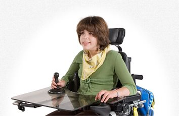 A young woman using a Rifton hand anchor in a wheel chair