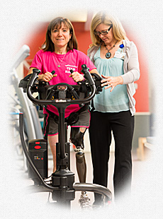 A rehabilitation patient with a bionic leg uses the Rifton TRAM to regain motor skills following a traumatic accident.