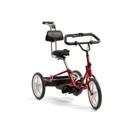 A red Rifton adaptive tricycle