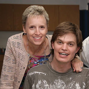 Dr. Karen McCain throws an arm around TBI recovery patient Sean Carter for an all smiles close-up.