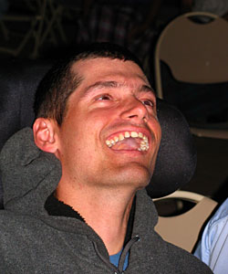 Duane who was diagnosed with infantile epilepsy at 3 months old laughs during a fireworks show