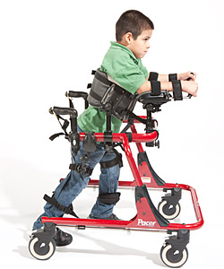 A young boy in a red Pacer uses prompts for pediatric positioning, moving forward in the device