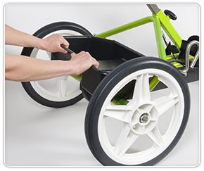 Removing the storage tote from the Rifton Adaptive tricycle