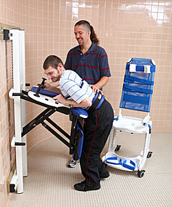 A young adult, with the help from her therapist uses the Rifton Support Station as toilet transfer equipment