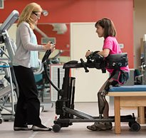 A patient uses the Rifton TRAM for sit to stand in the transfer mobility device video