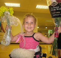Madi recieves flowers after dancing in her dynamic stander