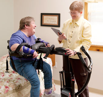 A caregiver uses the Rifton TRAM to perform a  patient transfer seat to seat lift