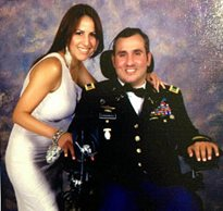 Romy Camargo decorated Army veteran and SCI patient poses for a photo with his wife at a fundraising event for his Stay in Step facility