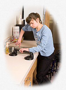 A young woman using a Rifton grab bars next to a sink